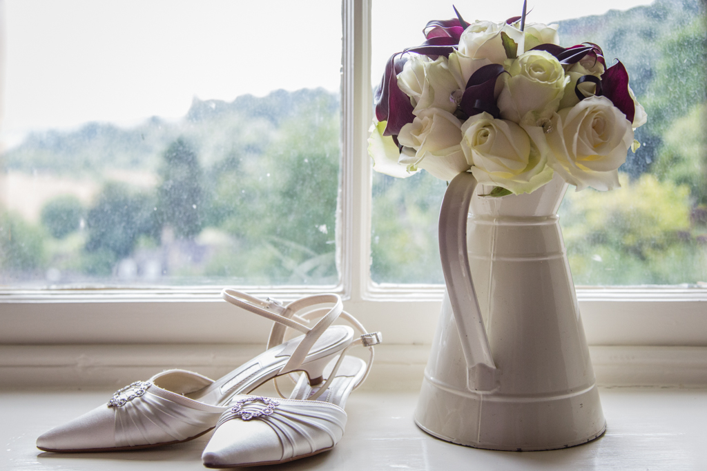 Brides shoes and flowers